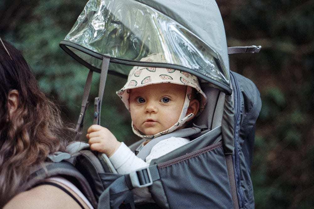 baby inside black backpack carrier